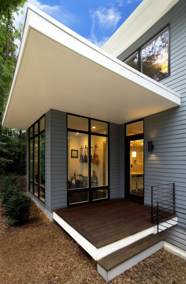 A1 Mulch for a Contemporary Exterior with a Windows and Riverside Residence by Moore Architects, PC