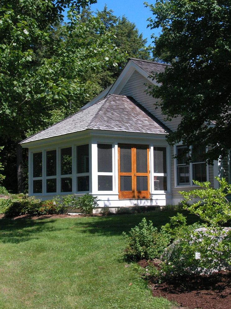 A1 Mulch for a Traditional Porch with a Screened in Porch and Screened Porch by by Design