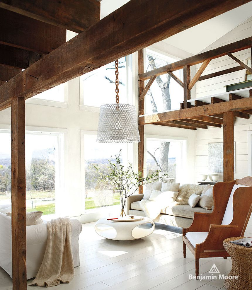 Acadian Style Homes for a Contemporary Living Room with a White Painted Floor and Benjamin Moore by Benjamin Moore