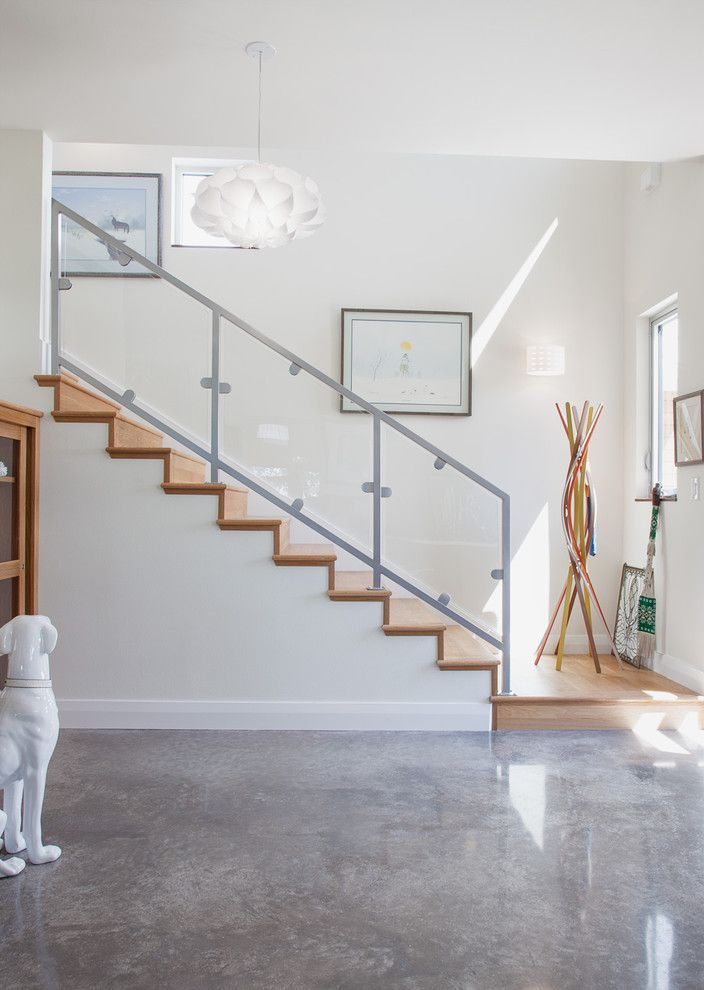 Acid Stained Concrete for a Contemporary Entry with a Concrete Floor and Hoffmanresidence Staircase by Kailey J. Flynn Photography