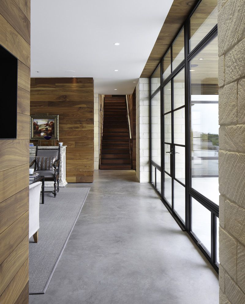 Acid Stained Concrete for a Contemporary Hall with a Dark Wood Staircase and Hill Country Residence by Cornerstone Architects
