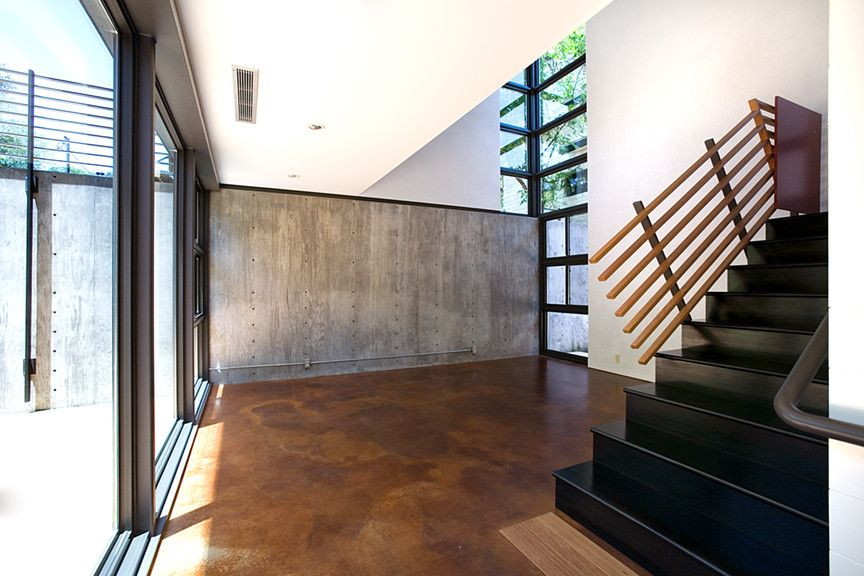 Acid Stained Concrete for a Modern Staircase with a Living Room and Newning House Living by Tom Hurt Architecture