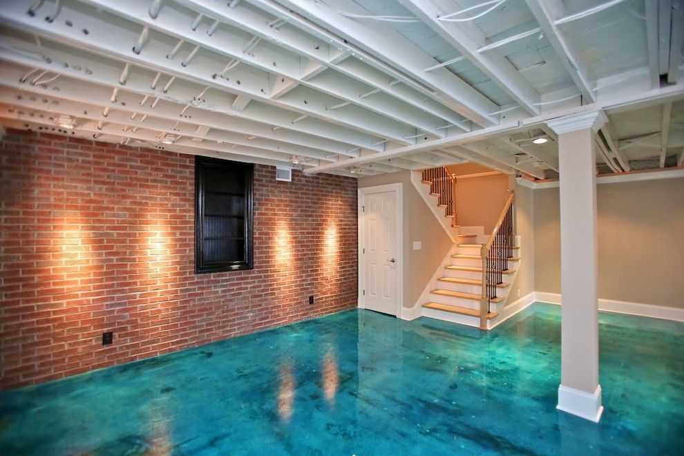 Acid Wash Concrete for a Contemporary Basement with a Painted Joists and Lake House by Jac Design