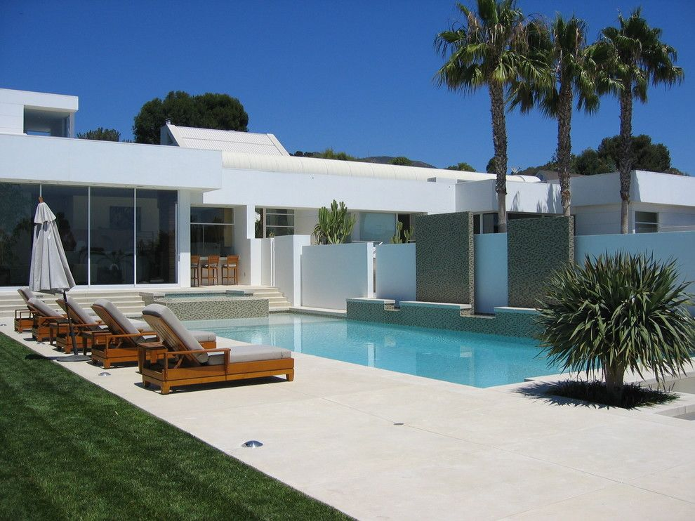 Acid Wash Concrete for a Contemporary Exterior with a Flat Roof and Malibu Residence by Sage Design Studios, Inc.