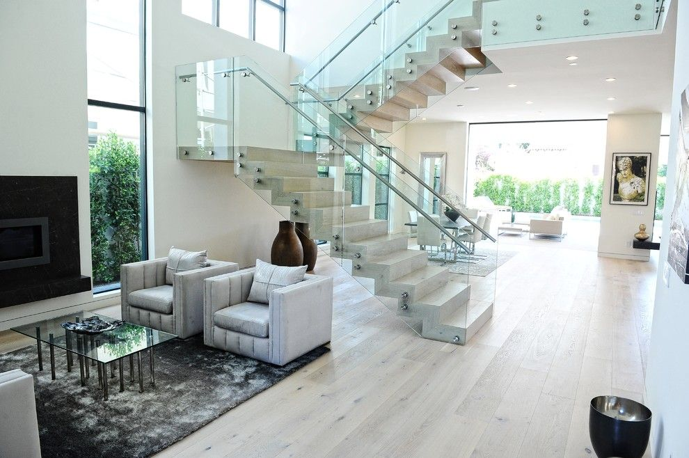 Acid Wash Concrete for a Contemporary Living Room with a Open Floor Plan and Adm Flooring Design by Adm Flooring Design