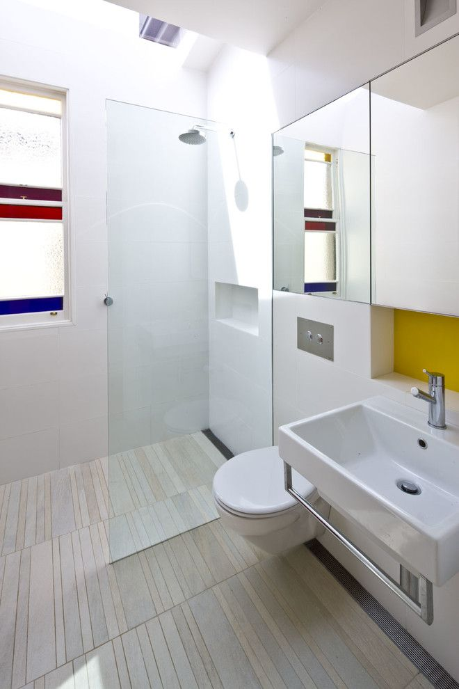 Ada Bathroom Layout for a Contemporary Bathroom with a Yellow Splashback and the 'Escher' House by Maccormick & Associates Architects