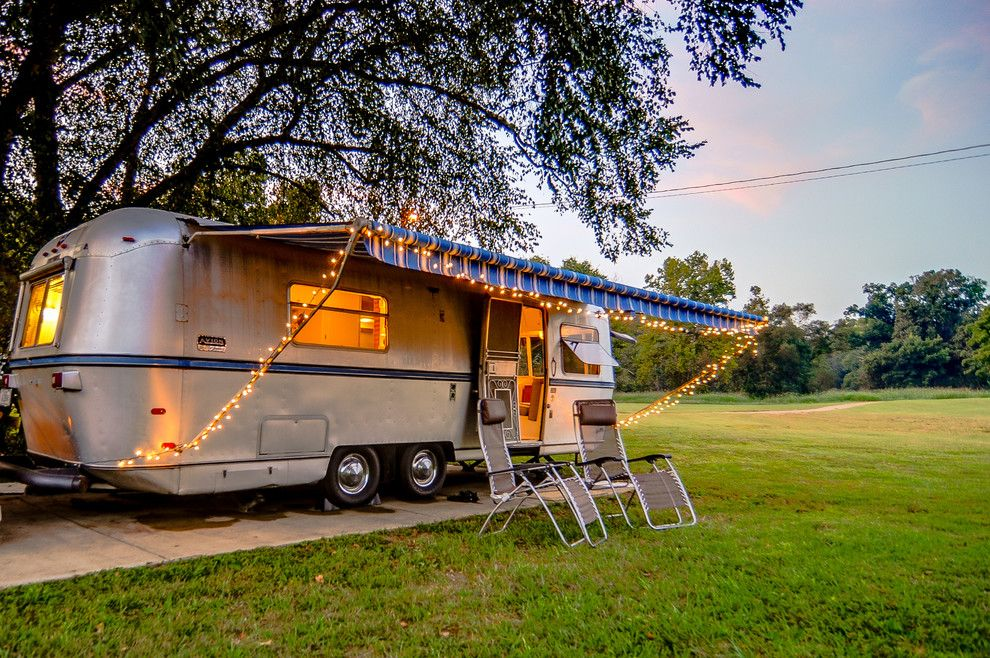 Airstream Renovation for a Midcentury Exterior with a Glamping and '72 Avion Camper Renovation by William Johnson Architect