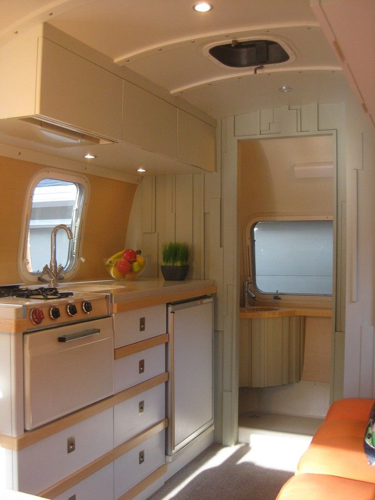 Airstream Renovation for a Midcentury Kitchen with a Airstream Renovation and 1971 Airstream by Amy Carman Design