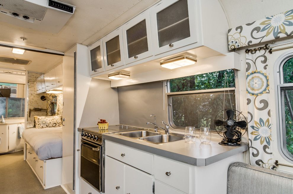 Airstream Renovation for a Midcentury Kitchen with a Glamping and '72 Avion Camper Renovation by William Johnson Architect