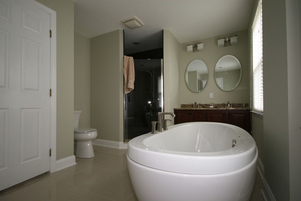 Aker Tubs for a Contemporary Bathroom with a Contemporary and Dao House by Evolved Interiors and Design Showroom