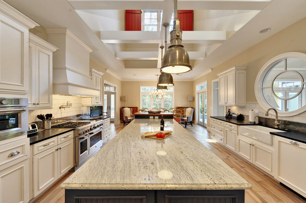 Alaska White Granite for a Beach Style Kitchen with a White Cabinets and Kitchen by Echelon Custom Homes