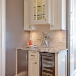Alaska White Granite for a Traditional Kitchen with a Wood Cabinets and Teri Turan by Turan Designs, Inc.