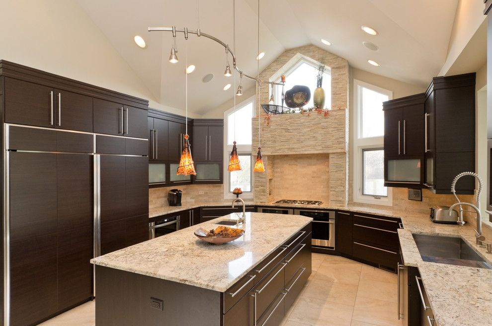 Alaskan White Granite for a Contemporary Kitchen with a Beige Wall and Kitchens by Bradford and Kent