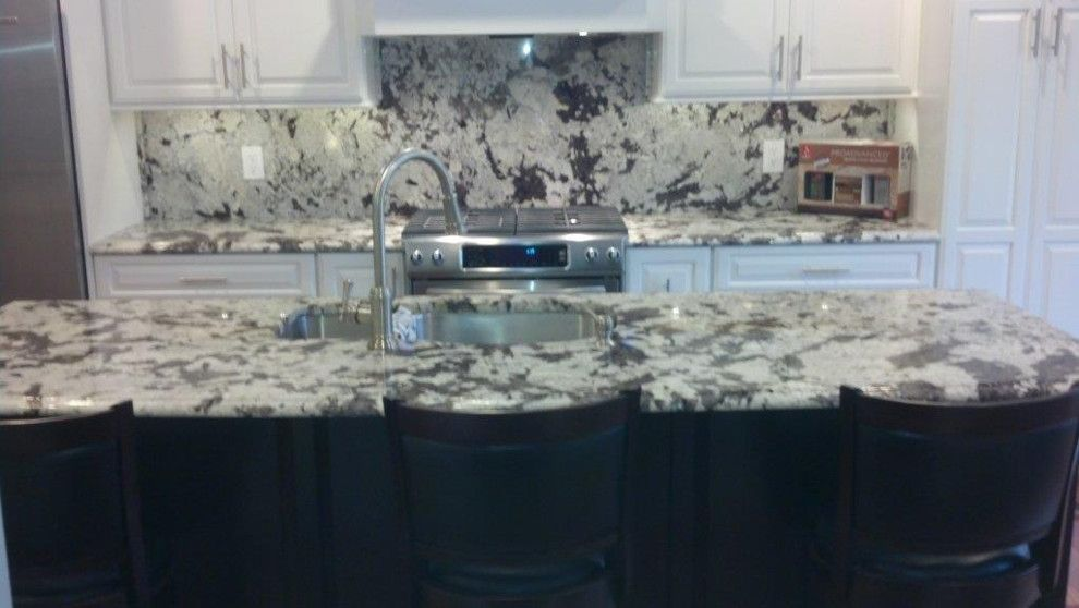 Alaskan White Granite for a Traditional Kitchen with a Island and Kitchen Counter and Back Splash by Abruzzi Stone & Flooring