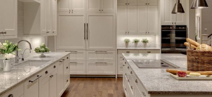 Alaskan White Granite for a Transitional Kitchen with a Wood Floor and Woodinville Retreat by Studio 212 Interiors