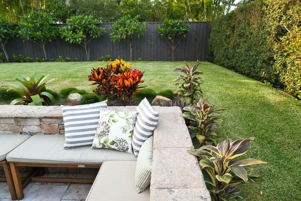 Alpine Fence for a Tropical Landscape with a Landscaping and Cooparoo 3 by Utopia Landscape Design