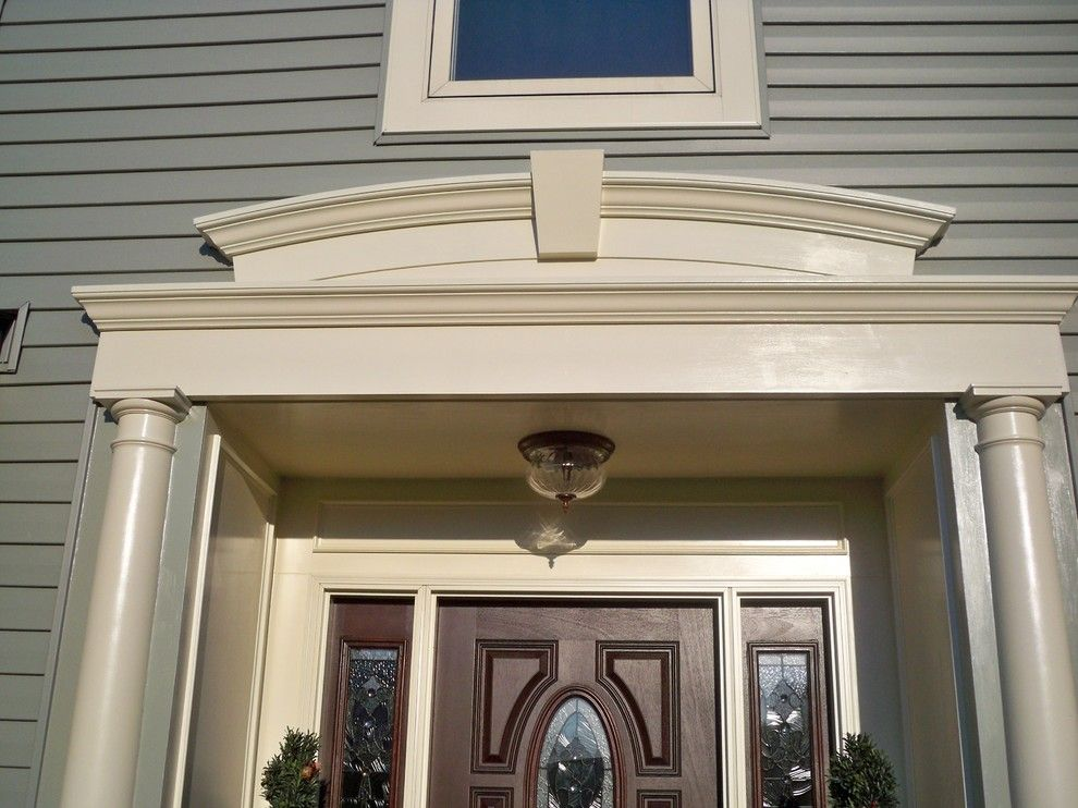 Alside for a Traditional Exterior with a Traditional and Vinyl Siding with Custom Azek Entry Trim. by Blue Tree Builders, Llc