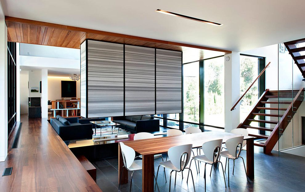 Altius for a Contemporary Dining Room with a U Shaped Staircase and Thorncrest House by Altius Architecture, Inc.