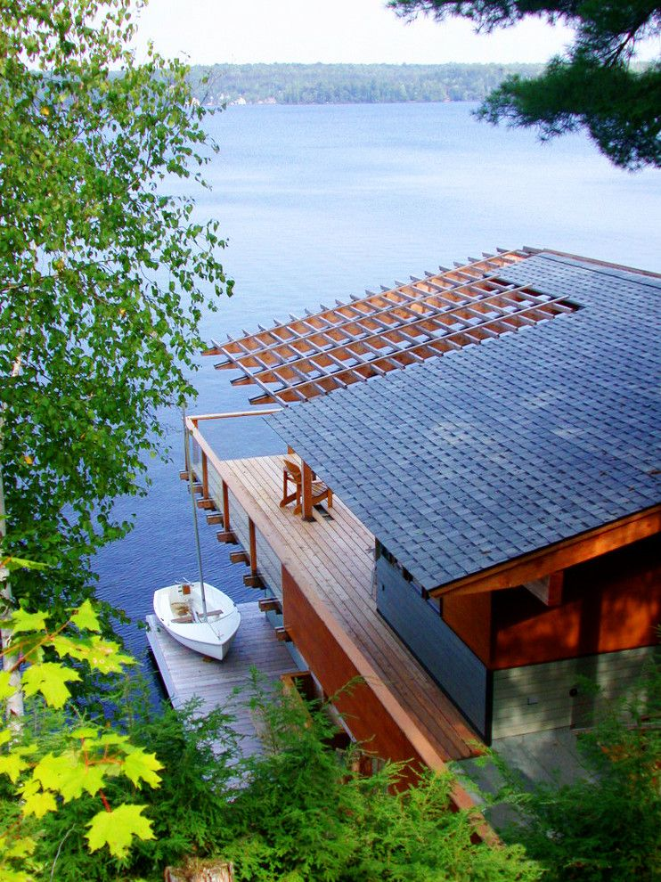 Altius for a Rustic Exterior with a Boathouse and Acton Island Boathouse by Altius Architecture, Inc.