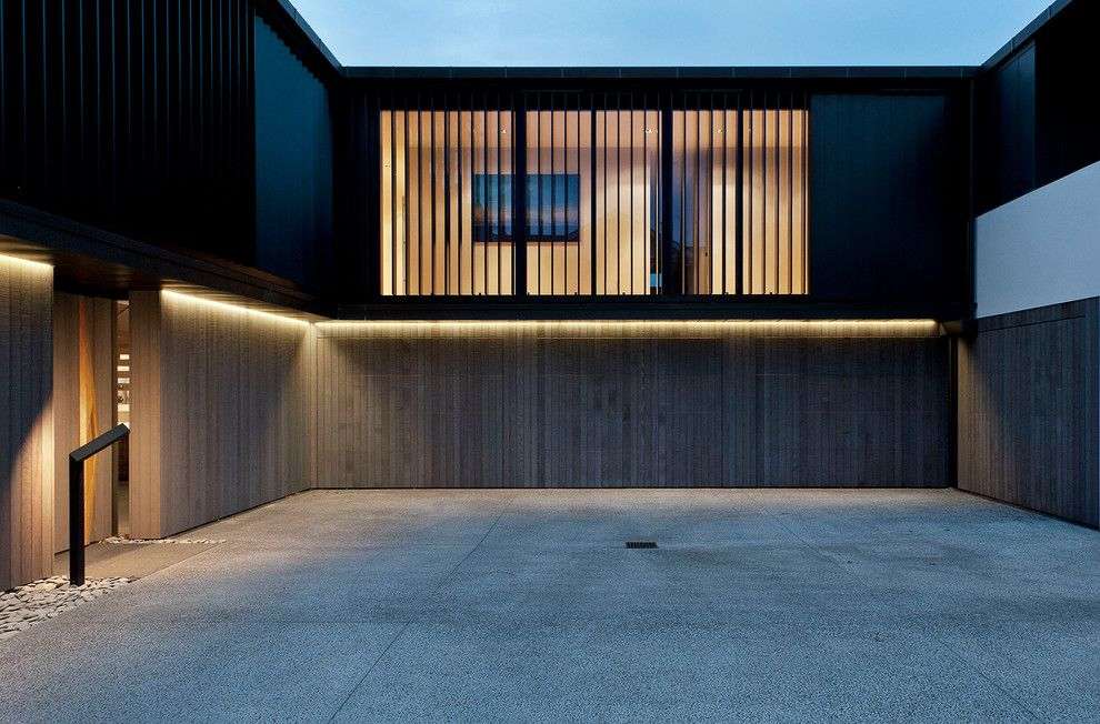 Amarr Garage Doors for a Contemporary Exterior with a Courtyard and Lucerne by Daniel Marshall Architect
