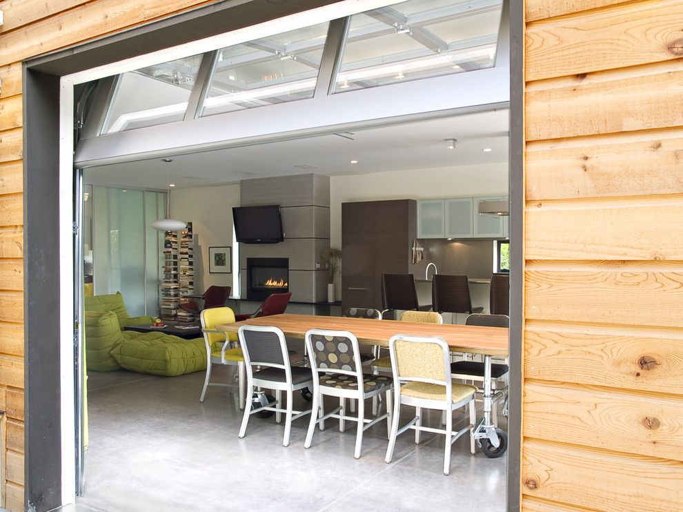 Amarr Garage Doors for a Industrial Dining Room with a Wood Dining Table and Ph 1 Dining by Place Architect Ltd.