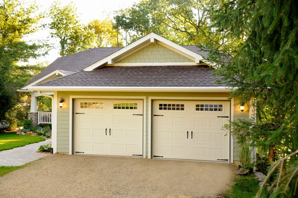 Amarr Garage Doors for a Traditional Garage with a Strap Hinge and 2 Car Garage by Jg Development, Inc.