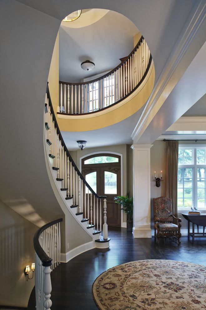 Ambella Home for a Traditional Staircase with a White Stair Railing and Curved Stairway and Front Door by Erotas Building Corporation