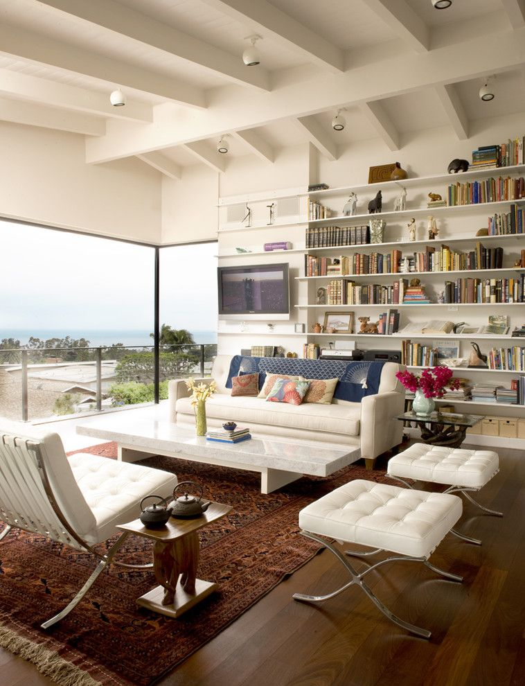 Ambiente Furniture for a Midcentury Living Room with a Side Table and Living Room by Laidlaw Schultz Architects