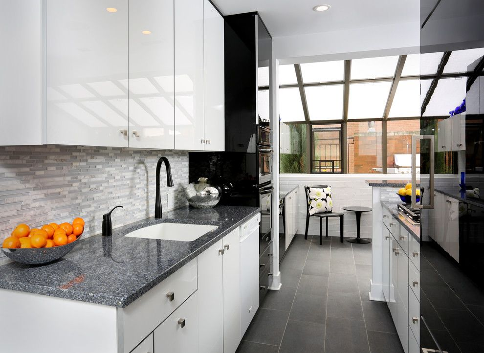 American Olean for a Contemporary Kitchen with a Galley Kitchen Ideas and Modern Galley Kitchen Design by Normandy Remodeling