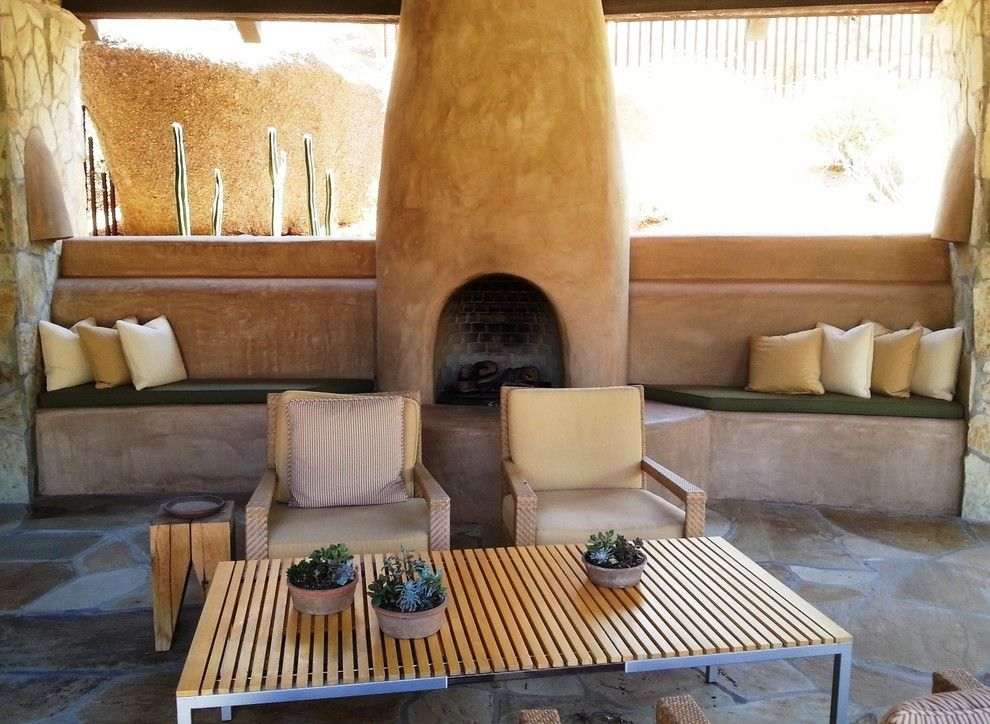 American Rattan for a Southwestern Patio with a Built in Window Seat and Estancia Club  Fireplace by Merit Landworks