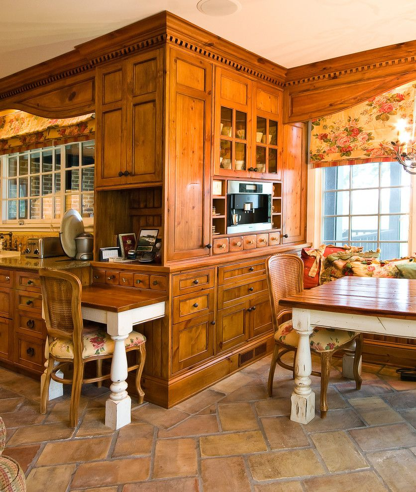 American Rattan for a Traditional Kitchen with a Glass Front Cabinets and Custom Built in Breakfast Room by Hostetler Custom Cabinetry