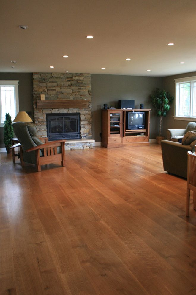 Anderson Plywood for a Modern Family Room with a Recliner and Wide Plank White Oak Floor by Magnus Anderson Hardwood Floors