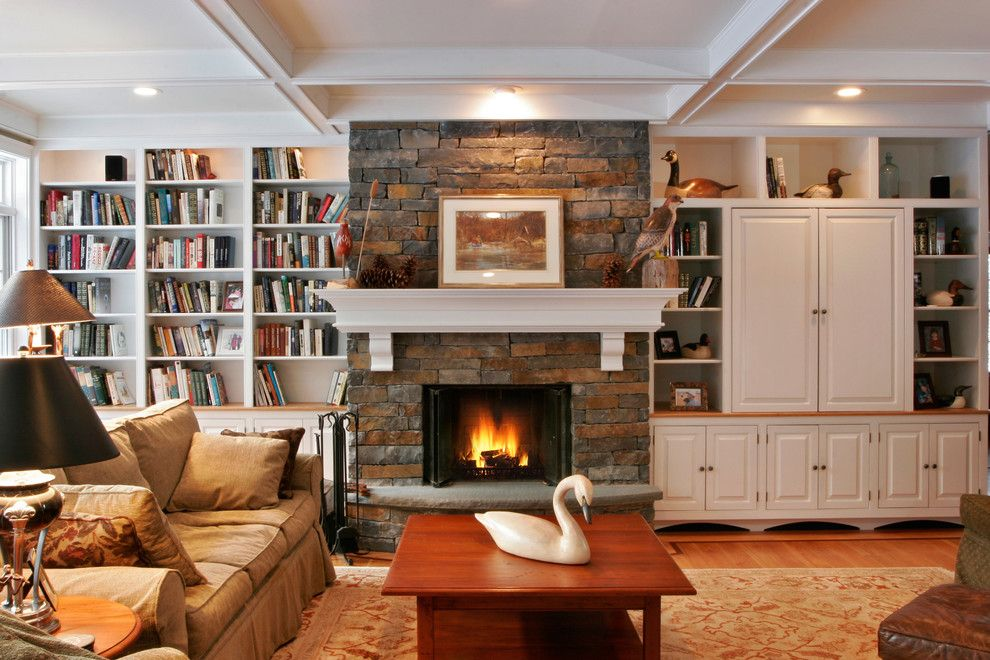 Annapolis Lighting for a Traditional Family Room with a Bookshelves and the Way You Live by Teakwood Builders, Inc.
