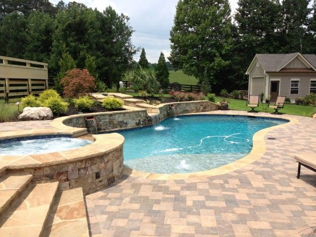 Aquarama for a Traditional Pool with a Waterfall and Luca Pool Build by Aquarama Pools & Spas