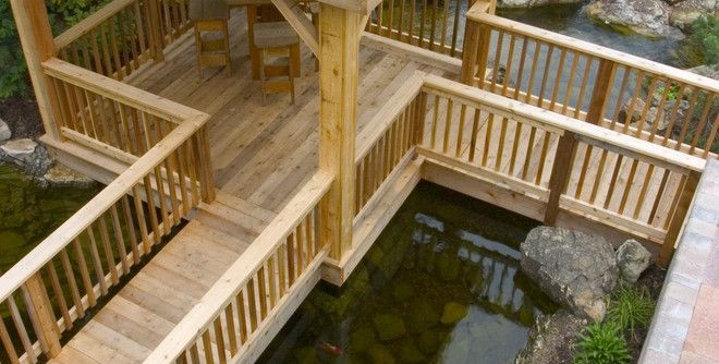 Aquascape for a Rustic Landscape with a Wooden Structure and Outdoor Living with Water Gardens by Aquascape Inc.
