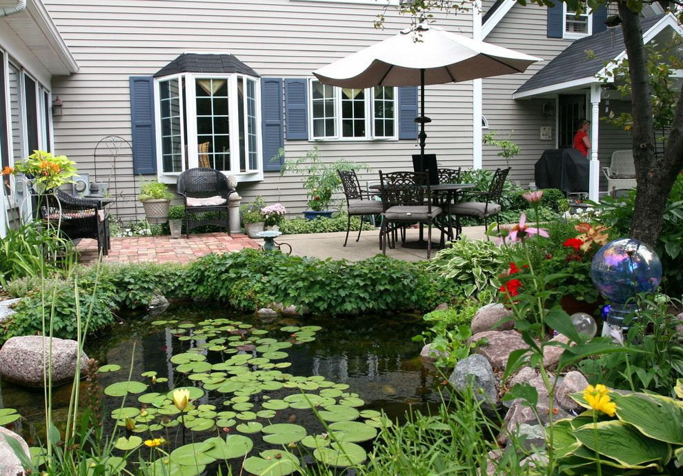 Aquascape for a Traditional Landscape with a Outdoor Dining and Outdoor Living with Water Gardens by Aquascape Inc.