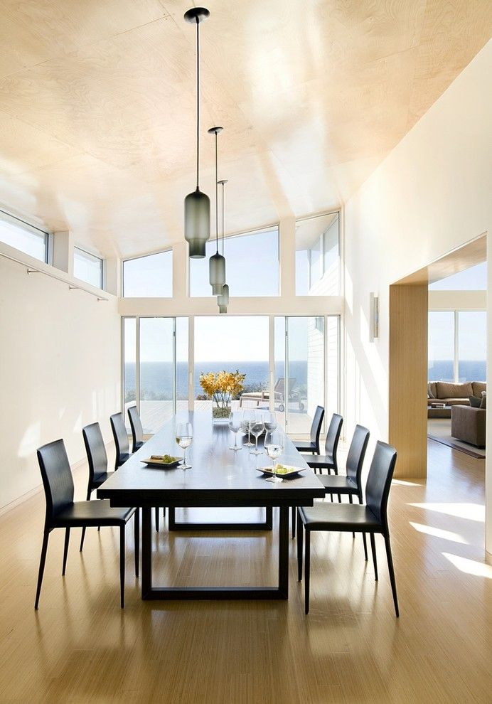 Arcadia Doors for a Modern Dining Room with a Modern and Modern Beach Home Dining by ZeroEnergy Design