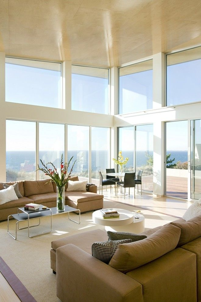 Arcadia Doors for a Modern Living Room with a Large Window and Oceanview Living by Zeroenergy Design