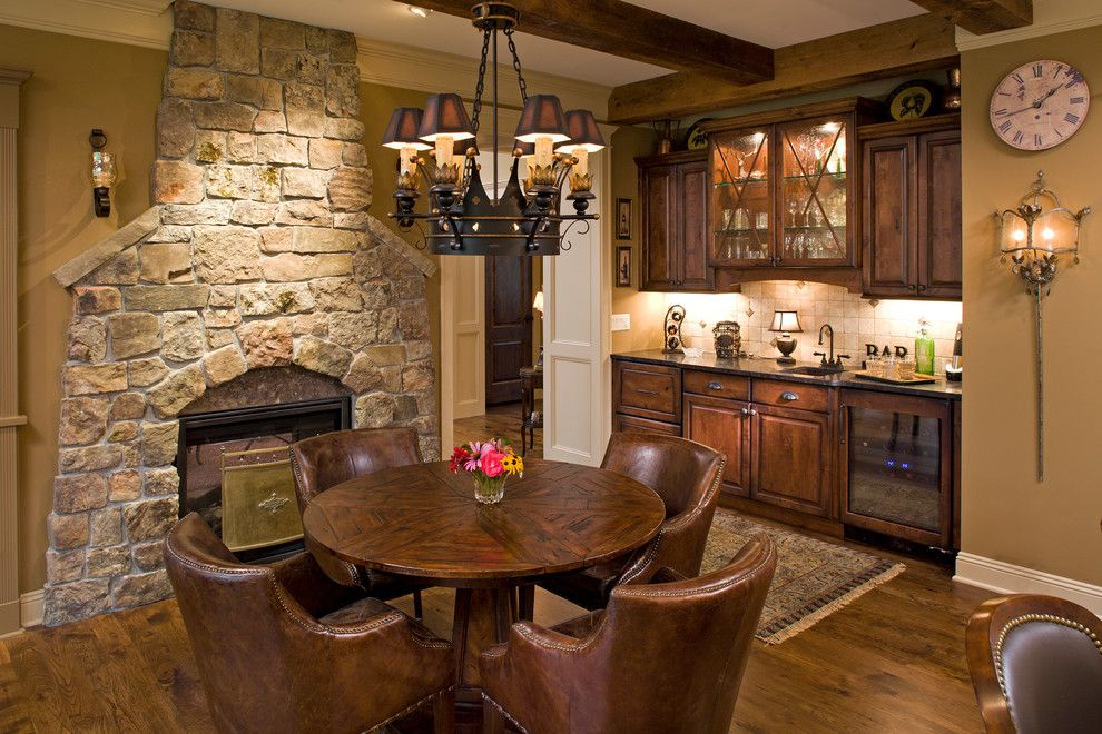 Arcadia Doors for a Traditional Family Room with a Wine Refrigerator and North Oaks   Traditional New Home by Bob Michels Construction, Inc.