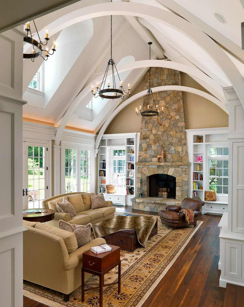 Arcadia Furniture for a Traditional Family Room with a Tall Fireplace and Family Rooms by Jan Gleysteen Architects, Inc