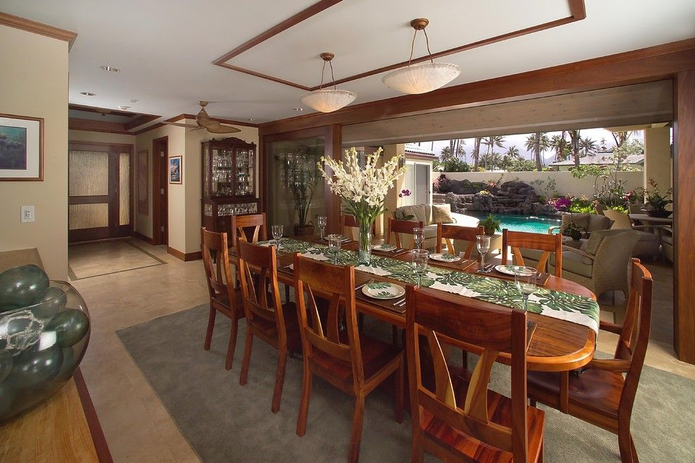Archipelago Lighting for a Tropical Dining Room with a Open Floor Plan and Koa by Archipelago Hawaii Luxury Home Designs