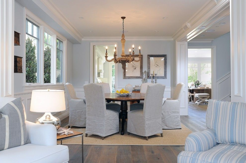 Architrave for a Beach Style Dining Room with a Slipcovers and Living and Dining Room by Dtm Interiors