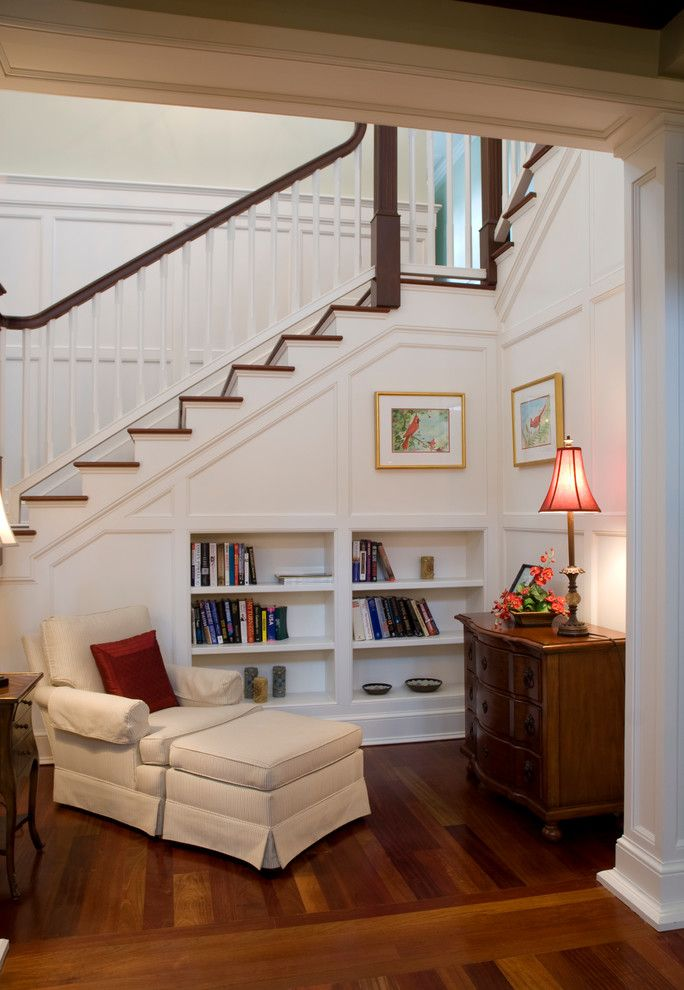 Architrave for a Traditional Entry with a Armchair and Bookcase by the Williams Group Inc.