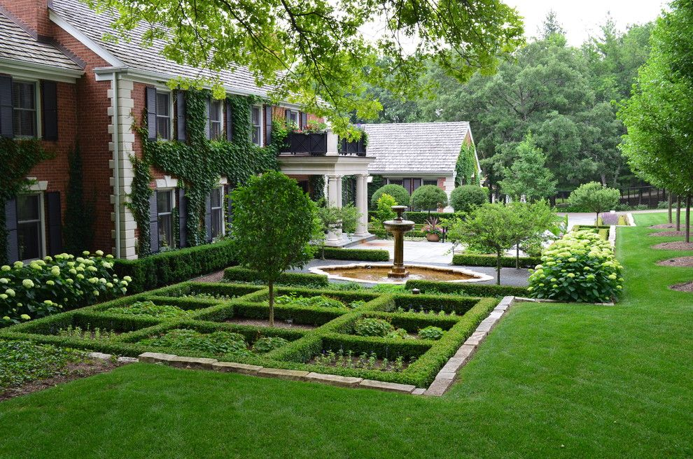 Armstrong Garden Center for a Traditional Landscape with a Balcony and Barrington Hills Formal Entrance by Doering Landscape Company