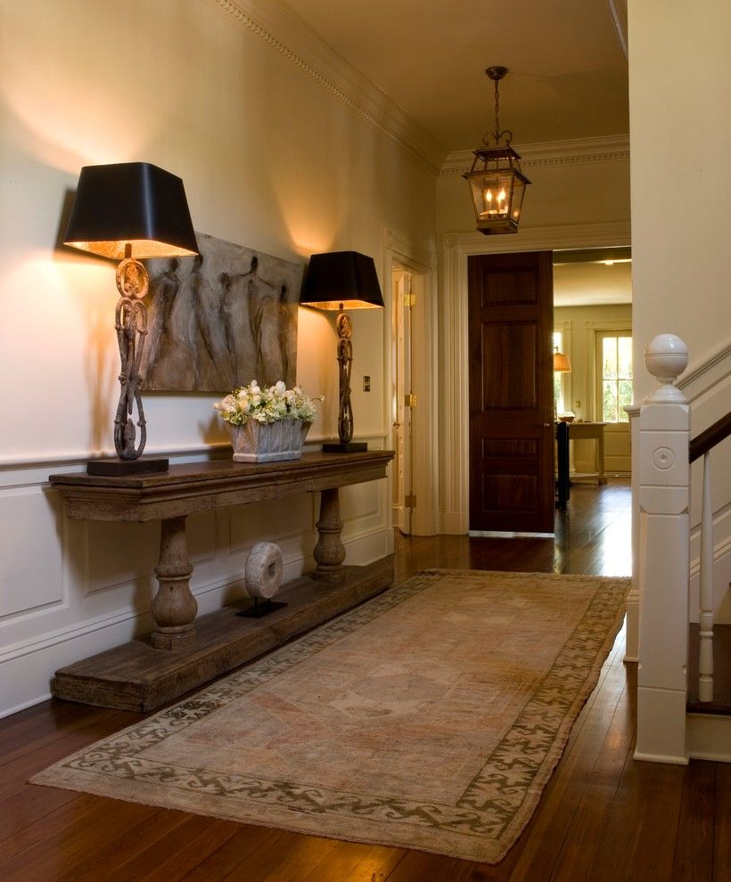 Arteriors Home for a Traditional Entry with a Crown Molding and Historic Downtown by Haute Design