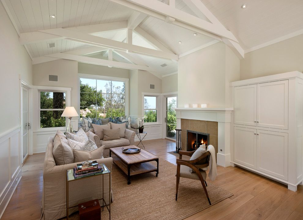 Arteriors Home for a Traditional Living Room with a White Armoire and East Mountain by Dd Ford Construction