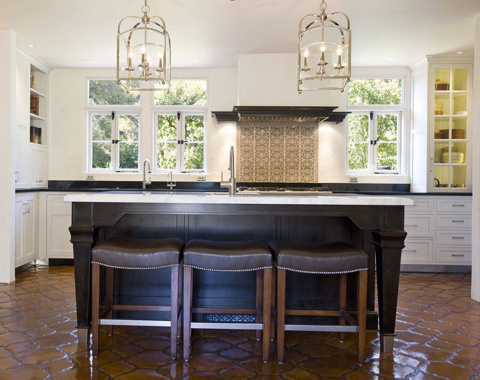 Arto Brick for a Mediterranean Kitchen with a Dark Stain and Montecito Residence by Lori Smyth Design