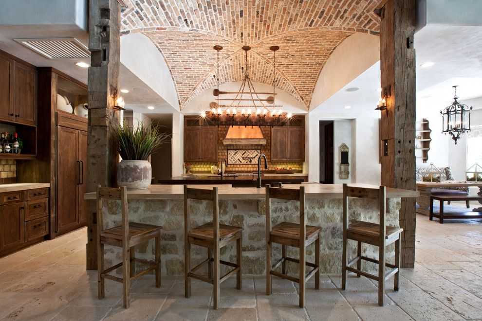 Arto Brick for a Mediterranean Kitchen with a Vaulted Ceiling and Tuscan Farmhouse by Eklektik Interiors