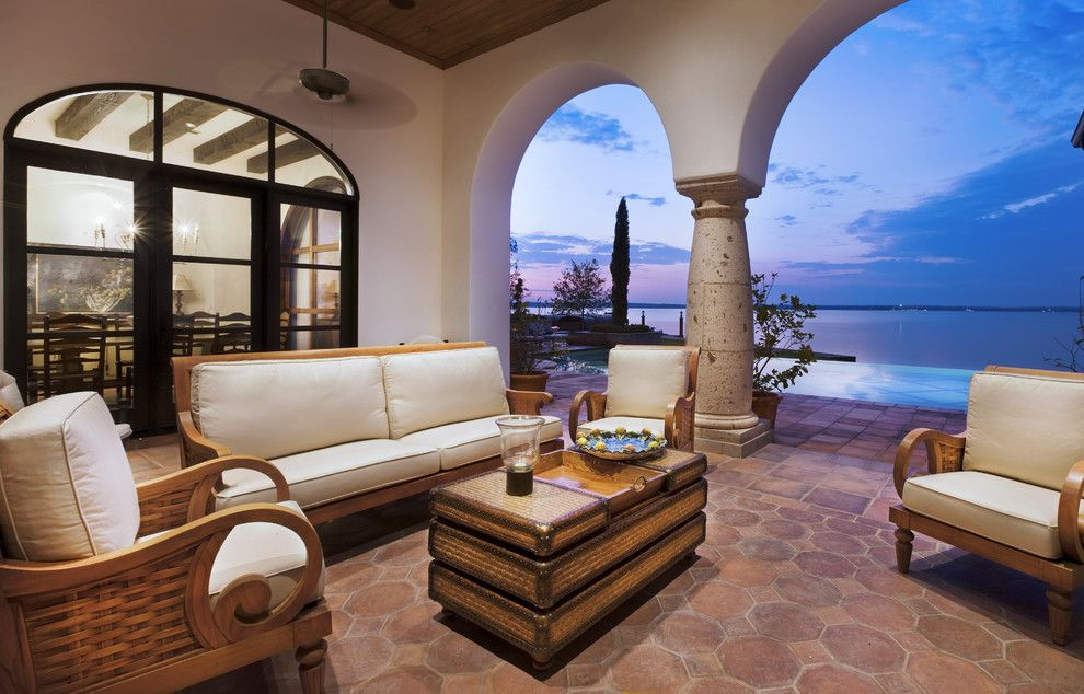 Ashley Furniture Reno for a Mediterranean Patio with a Terracotta Tiles and Lake Conroe Spanish by JAUREGUI Architecture Interiors Construction