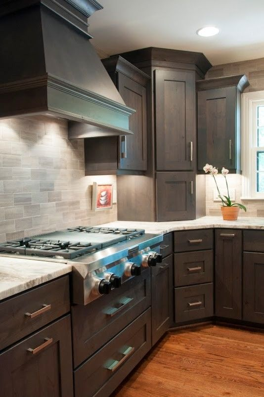 Ashley Norton Hardware for a Transitional Kitchen with a Dark Stain and Handsome in Alder by Terri Sears, Kitchen and Bath Designer